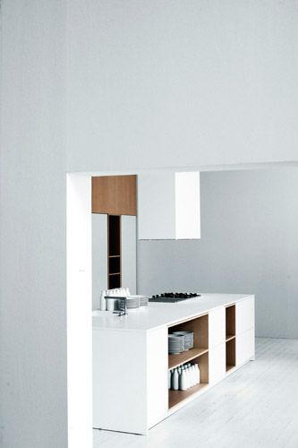 white kitchen with timber feature