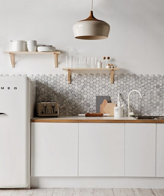 scandinavian kitchen featuring marble splash back