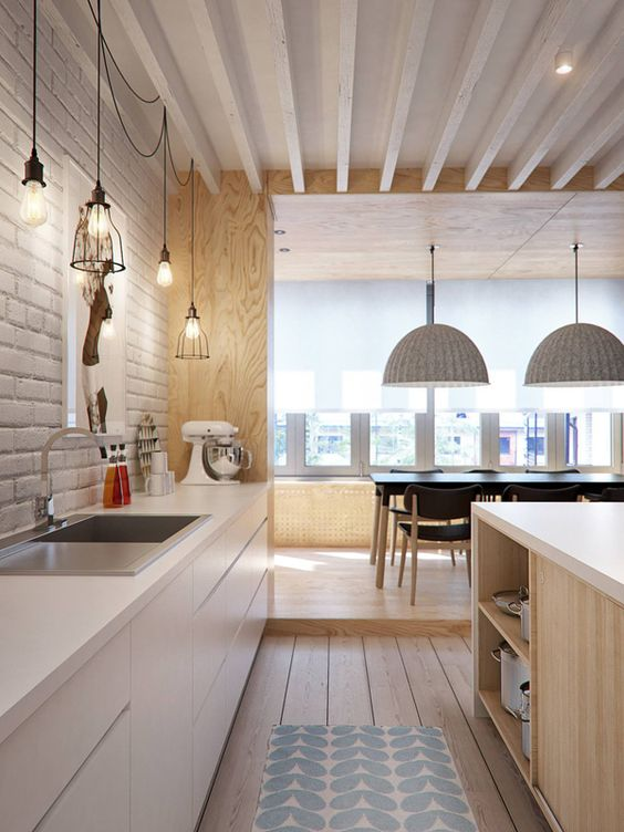 Classic and elegant white on timber mixing light timber tones with kitchen