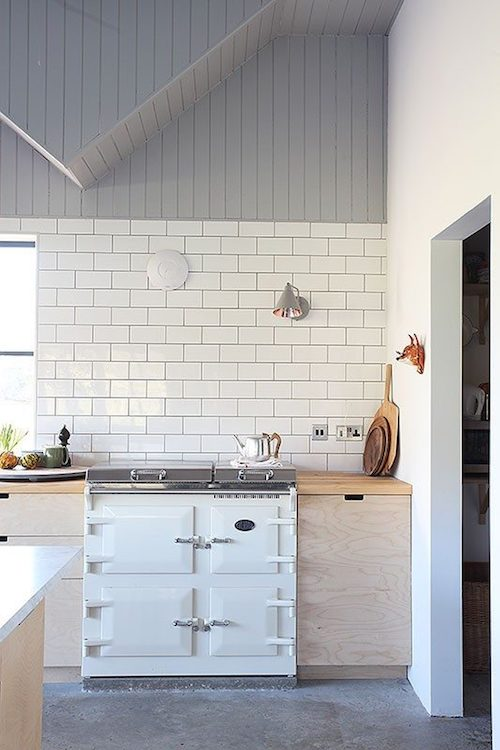 Plywood and subway tile farm style kitchen