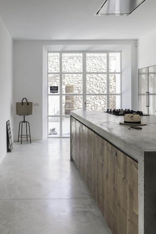 spanish farm style kitchen with concrete floors