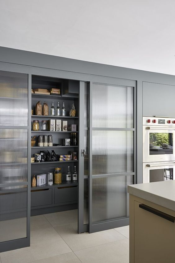 sliding door pantry in frosted glass